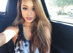 Beautiful asian girls take selfies in..